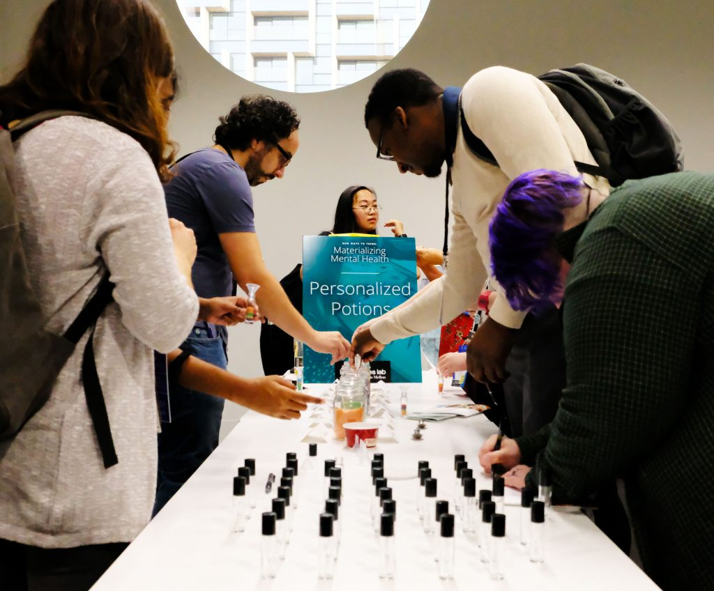 MozFest 2019 visitors make their personalised potions, facilitated by Jen Brown. Photo by Ulu Mills